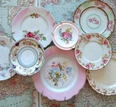 Shabby chic plate collection  *add pictures in center of plates for cute frame*