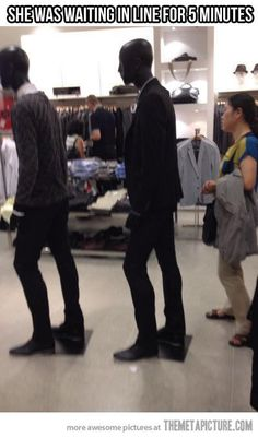Hahaha. ok this took me a few seconds to figure out. those two people are manikins.