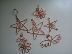 """12g copper wire Christmas ornaments are about 3"""" high. Made by Lady Ragnely."""