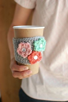 Spring coffee cup cozy with multicolored flowers by thecozyproject @Kenna - will you make me this??!!