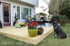 Outdoor patio redesign: new deck and colorful accessories bring life to an outdoor room!