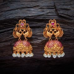 Historic Design Twin Peacock Antique Jhumka earrings studded with Ruby synthetic stones & Beads, with gold Polish.