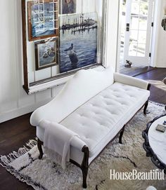 A tufted cushion on the Victorian sofa makes a very comfortable guest bed.   - HouseBeautiful.com