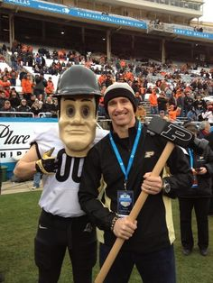 Purdue Pete with former Purdue quarterback Drew Brees at the 2013 Heart of Dallas Bowl.
