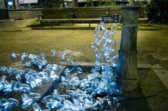 Luzinterruptus recycled bottle light installation in Madrid