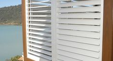 Porch and Patio Shutters for privacy and sun control. Porch shutters provide shade and decor for your outdoor living areas. Bermuda Shutters, Bahama Shutters, Outdoor Shutters, Exterior Shutters, Shutter Hardware, Shutter Doors, Diy Blinds, Shades Blinds, Door Trims