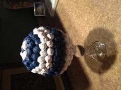 Nautical party centerpiece: dum dums wrapped in tissue paper stuck in a styrofoam ball