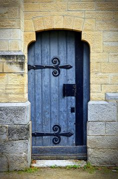 Sainte Blandine, France. We love the scrollwork, the color, and the utter French-ness of this door.