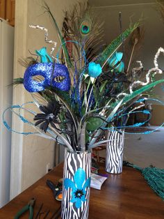 I have an arrangement similar to this, I could get a few sparkly things to spruce it up and add a mask to it