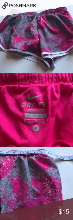 Nike Pink gray running short with panty size M Nike Dri-fit Pink and gray running short with panty size M. Shorts are in perfect condition. Please see pictures for details and measurements. Thanks for visiting my closet! Nike Shorts