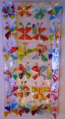 Fused glass butterflies made by students for a school auction