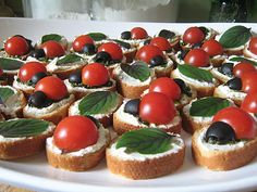 """For the adults, or kids with more mature tastebuds - I'd serve these delicious looking """"ladybug"""" crostinis.  #YoYoBirthday"""