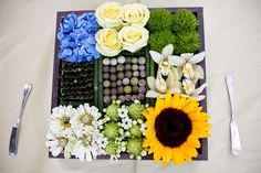 Mixture of flowers and plants. SMP wedding centerpiece.
