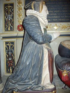 Tudor Effigies: Constance Lucy née Kingsmill (1601) - Side  It looks like there is a gold cap to the red tassel of the pillow in front of this effigy.