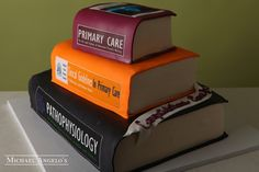 Medical Books #44Graduation  This cake is made in the shape of stacked books with a medical theme! Each layer is iced in buttercream and decorated to look like books. Perfect for any medical bookworm!