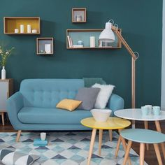 In this living roorm what would be the perfect dinner ? #ShopNow -- Click link in profil -- #Iceberg #Fjord #Nordic #sofa #shelves #lamp #carpet #coffeetable #yellow #vintage #blue #design #wood #homedecor #mymdm #maisonsdumonde