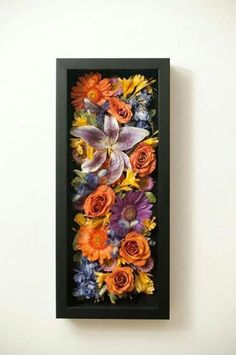 Disassembled wedding bouquet. Dried and placed in shadow box. You could also do…