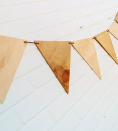 Plywood Bunting Banner by Against the Woodgrain  on Scoutmob Shoppe. Love this wood and leather pennant banner. Cool for a rustic fall wedding or just a fancy soiree.