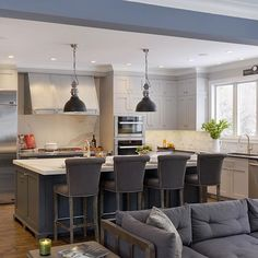 #tuesdaytraditionals showcases this beautiful #Westchester kitchen designed by Bilotta's Paulette Gambacorta. It features shaker- style cabinetry in two custom shades of grey, a beautiful #custom pewter hood and neolith countertops. #BilottaKitchens #expansive #classickitchen.