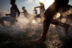 Athletes run into the Mediterranean Sea at the beginning of the Tel Aviv Triathlon in Tel Aviv, Israel, Saturday, June 22, 2013. (AP Photo/Oded Balilty)