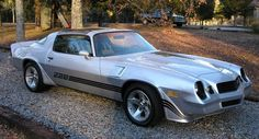 '81 Z-28 Camaro. Identical to this one with the super cool chrome silver interior. Only had it for about a week and got an offer I couldn't refuse :)