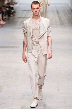 Yuri Pleskun walks for Costume National SS13