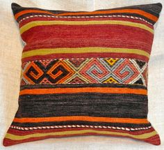 """#102 Kilim pillows from Turkey, wonderfully casual, strikingly rich. Following image pairs with this one. 18"""" sq. $260, pair"""