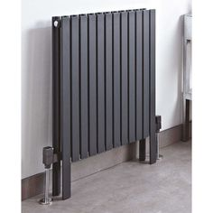 The Axim Anthracite Designer Radiator grips attention instantly. Designed for floor installation, it is suitable for use on water central heating systems only. Its dimensions ensure even distribution of heat as well as facilitating cleaning. Horizontal Designer Radiators, Bedroom Colors, Bedroom Ideas, Towel Rail, Heating Systems, Diy Design, Interior Decorating, Home Appliances, Flooring