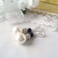 Big and Bold White Shell and Black Glass Bead Earrings  with a Silver Rhinestone Shambala and Silver Plated Filigreed Stud Posts