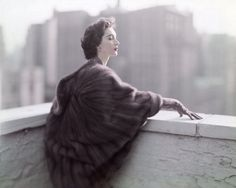 Dovima looking out over the great city of Paris, 1957. #vintage #fashion #1950s