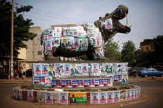 A statue of a hippopotamus is covered with election posters at a traffic circle in Bamako, Mali, Tuesday November 19, 2013. Mali is scheduled to hold parliamentary elections on Sunday, November 24, 2013, in an effort to finalize a return to democracy after a 2012 military coup. Last week residents reported an increase in armed Tuareg rebels in the northern Mali town of Kidal, underscoring the security risks that remain even after a French-led military intervention ousted al-Qaida-linked ...