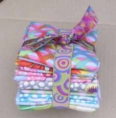 "Pastel Fabric Bundle by Kaffe Fassett - £35.00. This bundle contains 10 fabrics selected from the 20th Anniversary collection. Free p&p in the UK for the month of May 2016 PLUS entry into a draw for 1 months FREE subscription.  This delicious bundle of 10 pastel fabrics (each approx 19""x22"") have been selected from the 20th Anniversary range of Kaffe Fassett Collective Prints."