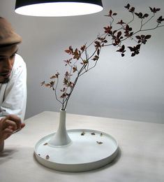 Studio Note: floating flower (2008) | a flower vase that is designed to equally appreciate beauty in the plant's imminent death, as well as in its life
