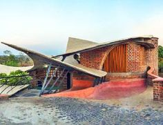 Mumbai-based iStudio Architecture completed Brick House, a curvaceous and organic structure that looks like the picture-perfect yoga retreat. Located in rural Wada near Mumbai, India, the 2,500-square-foot house was constructed from locally sourced materials like brick, stone, wood, bamboo, and ferro-concrete to keep costs low and give the space an earthy feel. The home was also designed with rat-trap bond brickwork, passive technologies, and large arched openings that take in generous…