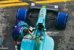 Ivan Capelli of Italy sits aboard the Leyton House Racing Leyton House CG911 Ilmor V10 holding the Momo steering wheel during practice for the...
