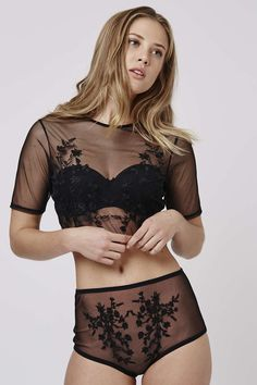 Add sultry sheer mesh to your lingerie drawer with this gorgeous embroidered crop top. With an all-over sheer finish, it comes embroidered with elegant florals to the bust. #Topshop