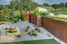 The cor-ten steel retaining walls are gorgeous