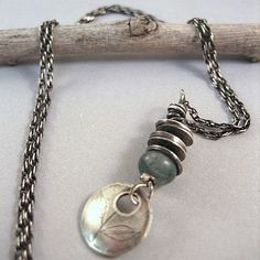 I like the look the stacked saucers give this piece OCEAN NECKLACE Sterling silver Discs with Kyanite by inkjewelry