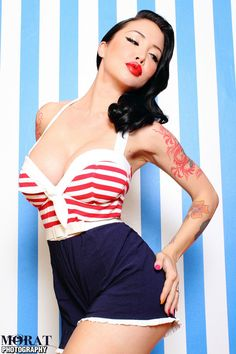 What is more perfect for the 4th of July than this patriotic playsuit!? Sailor Playsuit w/ Red and White Stripes and Ruffle Trimmed Navy Bengaline Shorts by #PinupCouture When you're not actually going into the pool, but would like to romp around looking adorable, this #playsuit is the way to go. Padded for structure, finished off w/ great fitting shorts, this #nautical #romper will be your favorite summer look. #PinupGirlClothing #Patriotic #4thofjuly #vintage #vintageinspired #1950s