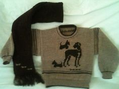 Carol Charnock Creation:-A  lovely doggy jumper and matching scarf for our favourite charity 'Loving Hands' in Scotland. Made to fit an 8 to 10 year old.