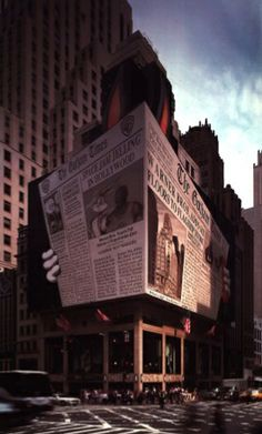 A giant hoarding promoting the new Warner Brothers building opening in Times Square. - The Partners 1996