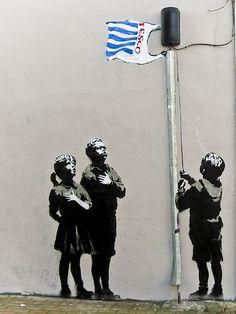 Banksy art depicting children pledging allegiance to the flag of Tesco.