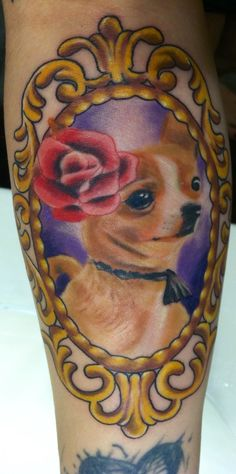 Chihuahua in gold frame. I swear she's smiling.  Atomic tattoo Austin tx Nate H