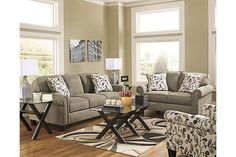 """The Gusti Sofa from Ashley Furniture HomeStore (AFHS.com). With the stylish comfort of sleek rolled arms and plush back cushions supported by rich finished accent wood feet, the """"Gusti-Dusk"""" upholstery collection uses soft upholstery fabric surrounding a relaxed contemporary design to create a warm inviting collection that fits comfortably into any home."""
