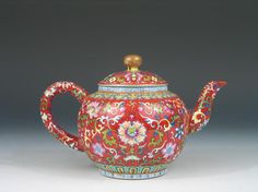 A Marvelous Antique Chinese Famille Rose Porcelain Teapot, Qianlong Mark. Ht: 4 inches. Distance from handle to spout: 7 inches. Biggest diameter 4 inches. Reference: A similar Qianlong imperial teapot can be found in the K.S. Lo Collection in the flagstaff House Museum of Tea Ware. Urban Council, 1984. Hong Kong. P. 152. #79.