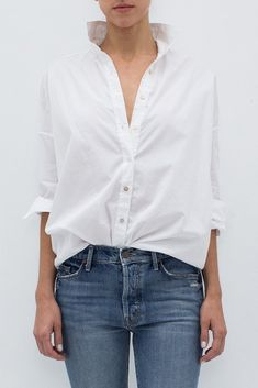 """- 100% Cotton - Poplin - Full button placket with collar - Grosgrain detailed drop shoulders - 3/4 length sleeves - Shirttail hem - Color: White - Model is 5'9"""" and wears a size T1."""