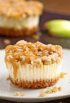 All of the sweet and caramely goodness of a caramel apple crisp cheesecake packed into perfect portable fall dessert – Caramel Apple Crisp Mini Cheesecakes.