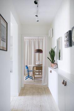 Narrow hallway with Ikea 'Besta' cabinet