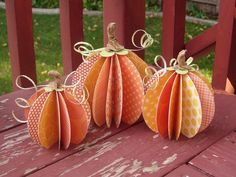 Make an easy 3D paper pumpkin centerpiece for fall.