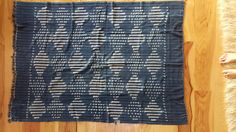 We call this one Steve Miller...  This Vintage African Mudcloth textile was handwoven in Mali, West Africa. This is a rare vintage find and it is as soft and supple as you can imagine. We love the wonderful pattern that has taken the home decor world by storm. This piece of vintage indigo will make a lovely addition to your home. Toss it over the side or back of your sofa, at the foot of your bed, or as an added layer to your headboard or a bench. Bring a bit of the world into your own home…